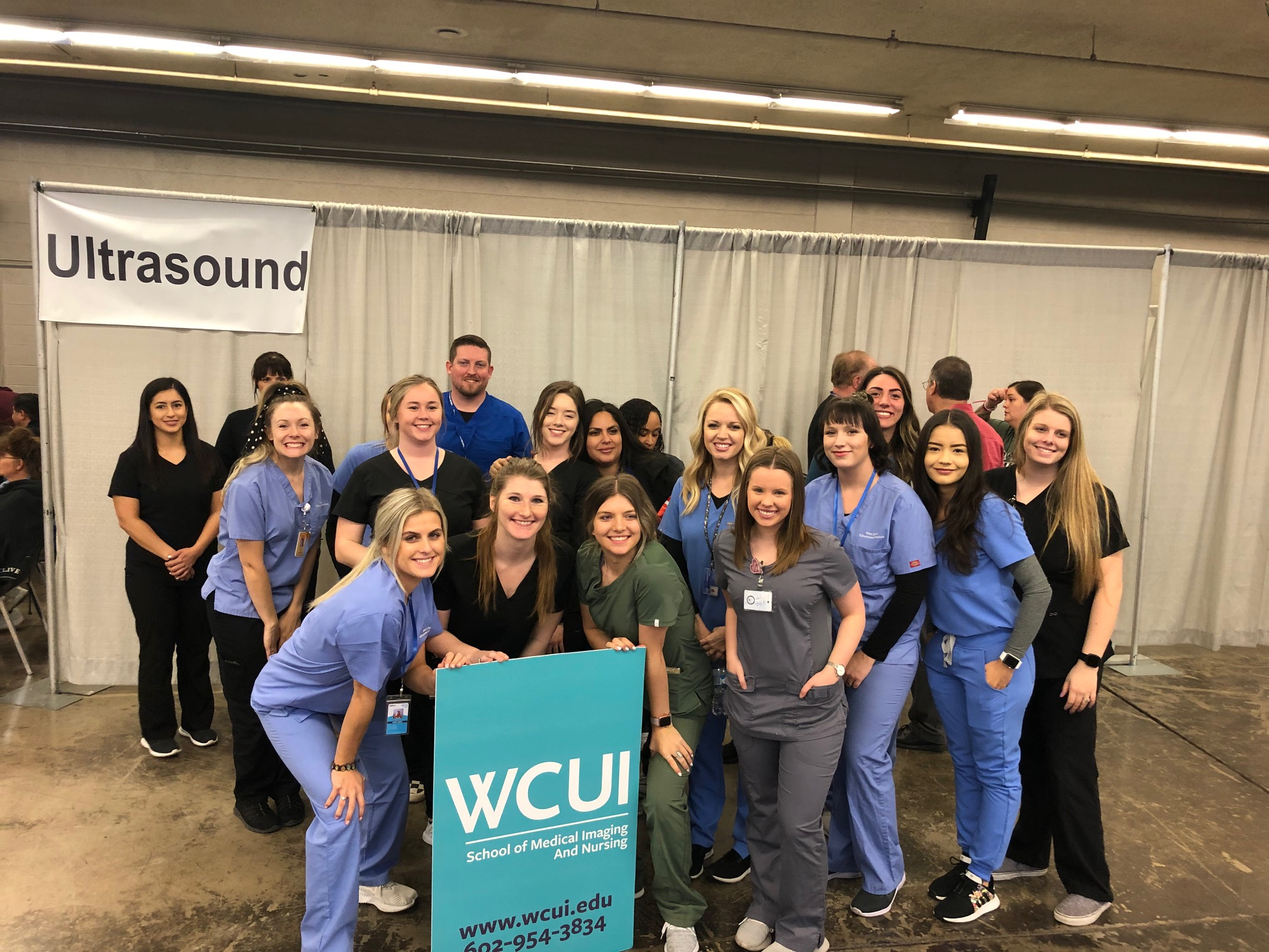 WCUI Student and Staff smiling in a group photo after the MC StandDown